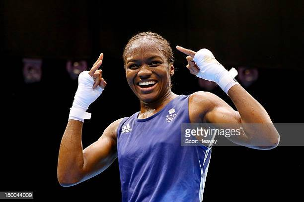Nicola Adams of Great Britain celebrates winning her bout against Cancan Ren of China during the Women's Fly Boxing final bout on Day 13 of the...