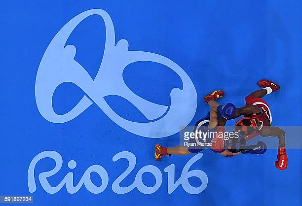 Nicola Adams of Great Britain fights against Cancan Ren of China during a Women's Fly Semifinal bout on Day 13 of the 2016 Rio Olympic Games at...