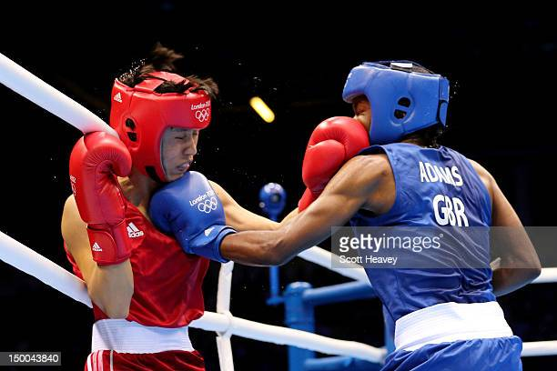 Nicola Adams of Great Britain in action against Cancan Ren of China during the Women's Fly Boxing final bout on Day 13 of the London 2012 Olympic...