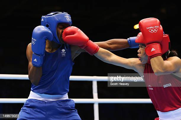 Nicola Adams of Great Britain in action against Chungneijang Mery Kom Hmangte of India during the Women's Fly Boxing semifinals on Day 12 of the...