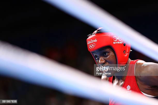 Nicola Adams of Great Britain looks on against Cancan Ren of China during a Women's Fly Semifinal bout on Day 13 of the 2016 Rio Olympic Games at...
