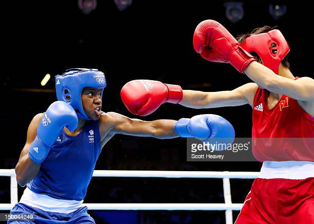 Nicola Adams of Great Britain throws a punch against Cancan Ren of China during the Women's Fly Boxing final bout on Day 13 of the London 2012...