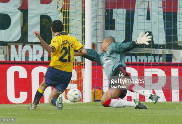 Nicola Amoruso of Modena scores past AC Milan's keeper Dida during the Serie A match between AC Milan and Modena at Modena's Alberto Braglia's...