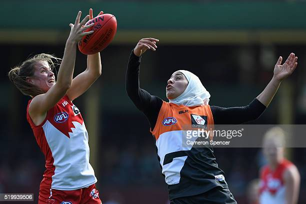 Nicola Barr of the Swans contests the ball with Lael Kassem of the Giants during the Women's AFL Exhibition match between the Sydney Swans and the...