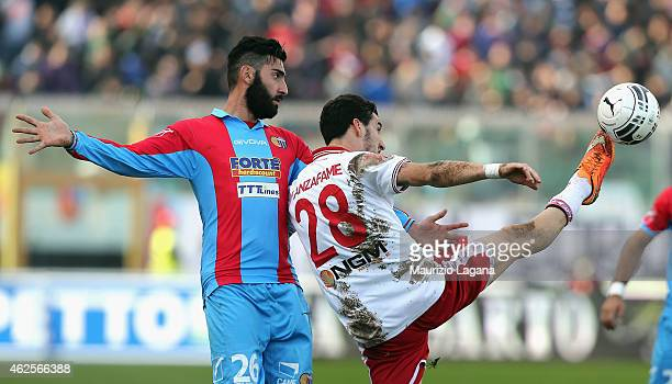 Nicola Belmonte of Catania competes for the ball with Davide Lanzafame of Perugia during the Serie B match between Calcio Catania and AC Perugia at...