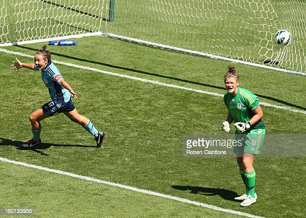 Nicola Bolger of Sydney FC celebrates her goal past Victory goalkeeper Brianna Davey during the WLeague Grand Final between the Melbourne Victory and...