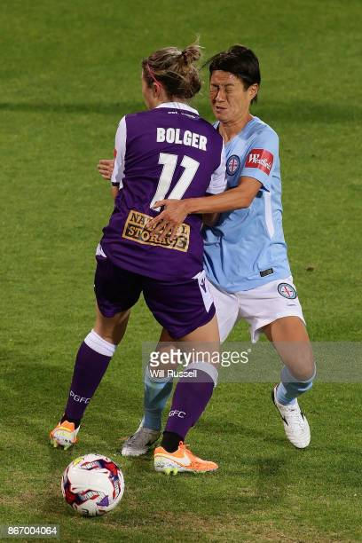 Nicola Bolger of the Glory and Yukari Kinga of Melbourne City collide during the round one WLeague match between the Perth Glory and Melbourne City...