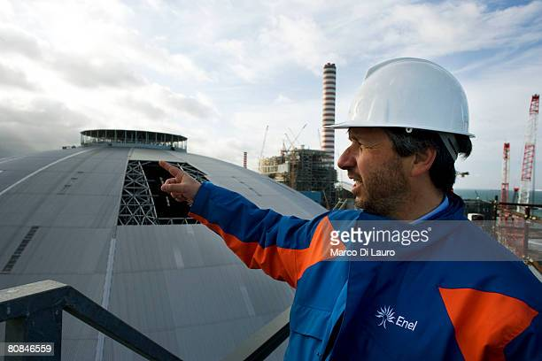 Nicola Brancaleoni, from the Enel Energy Management General Division shows the silvery dome of theTorrevaldaliga Nord Enel Coal Plant is seen on...
