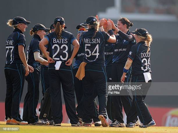 Nicola Browne of New Zealand celebrates the wicket of Charlotte Edwards captain of England with team mates during the Super Sixes match between...