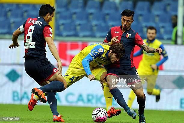 Nicola Burdisso and Armando Izzo of Genoa CFC in action against Alberto Paloschi of AC Chievo Verona during the Serie A match between Genoa CFC and...