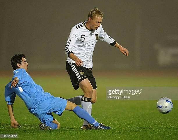 Nicola Canini of San Marino challenges Felix Bastians of Germany during the UEFA U21 Championship match between San Marino and Germany at Olimpico...