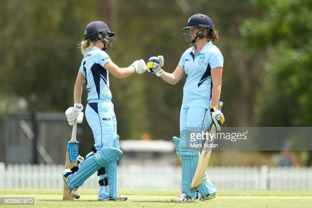 Nicola Carey and Rene Farrell of NSW meet mid wicket during the WNCL Final match between New South Wales and Western Australia at Blacktown...