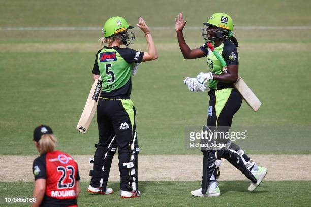 Nicola Carey and Stafanie Taylor of the Thunder celebrate the winning runs during the Women's Big Bash League match between the Melbourne Renegades...