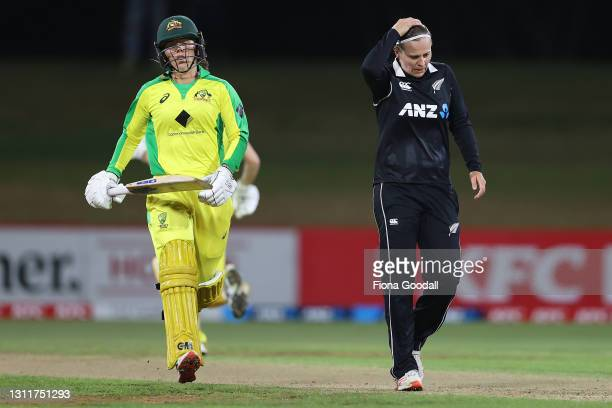 Nicola Carey of Australia runs between the wickets while bowler Lea Tahuhu of New Zealand reacts during game three of the One Day International...