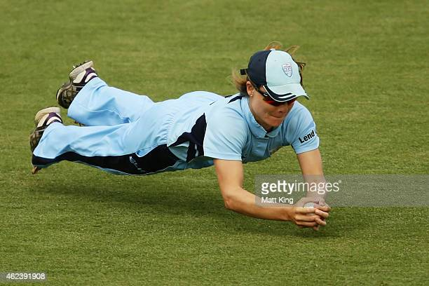 Nicola Carey of the Breakers takes a diving catch to dismiss Jess Cameron of Victoria during the Women's Twenty20 final match between New South Wales...