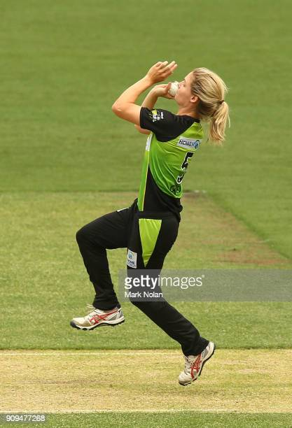 Nicola Carey of the Thunder bowls during the Women's Big Bash League match between the Sydney Thunder and the Melbourne Renegades at Manuka Oval on...