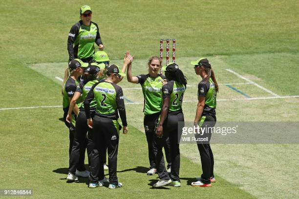 Nicola Carey of the Thunder celebrates the wicket of Elyse Villani of the Scorchers during the Women's Big Bash League match between the Sydney...