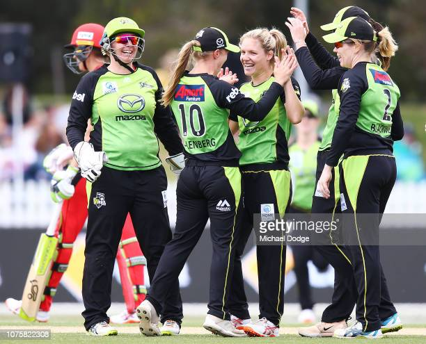 Nicola Carey of the Thunder celebrates the wicket of Emma Inglis of the Renegades during the Women's Big Bash League match between the Melbourne...