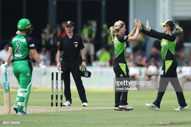 Nicola Carey of the Thunder celebrates with Alex Blackwell of the Thunder after taking the wicket of Katie Mack of the Stars during the Women's Big...