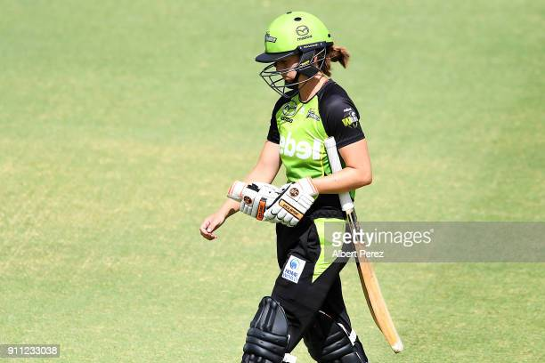 Nicola Carey of the Thunder walks off the field after being caught out by Kirby Short of the Heat during the Women's Big Bash League match between...