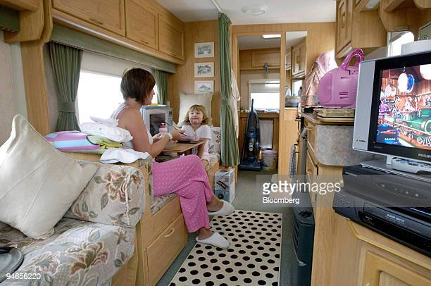 Nicola Caster left sits with her daughter Holly inside their caravan on California Drive in Catcliffe Sheffield UK on Tuesday Aug 7 2007 Caster and...