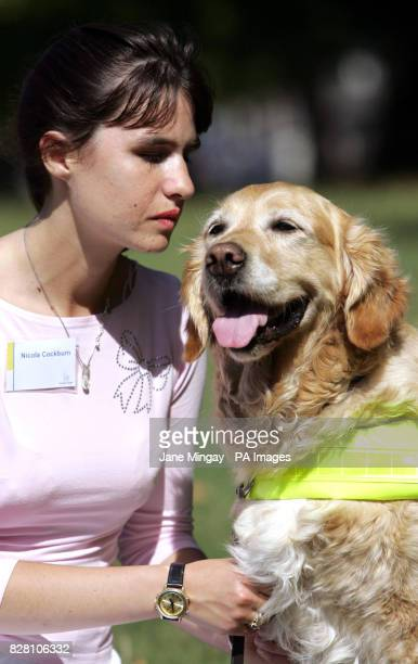 Nicola Cockburn from Llandudno Wales poses with her nineyearold golden retriever cross guide dog 'Vale' after he was crowned 'Exceptional Work Gude...