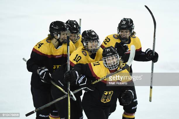 Nicola Eisenschmid of Germany celebrates scoring a goal with team mates during the Women's Ice Hockey International Friendly match between Japan v...