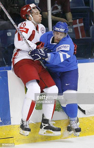 Nicola Fontanive of Italy hits Morten Dahlmann of Denmark in the boards in the first period during the preliminary round at the 2008 IIHF World...