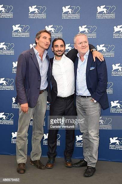 Nicola Giuliano , Piero Messina and Fabio Conversi attends a photocall for 'The Wait' during the 72nd Venice Film Festival at Palazzo del Casino on...