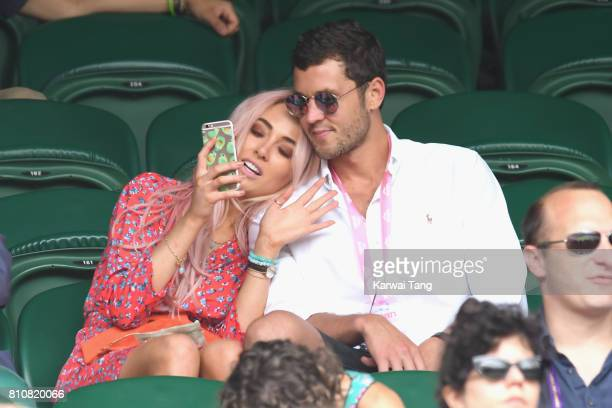Nicola Hughes and a guest attend Wimbledon as evian guests during day 6 on July 8 2017 in London England