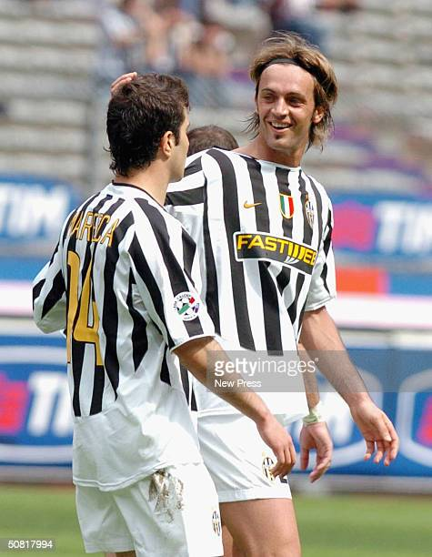 Nicola Legrottaglie celebrates with Enzo Maresca of Juventus after scoring a goal during the Serie A match between Juventus and Sampdoria played at...