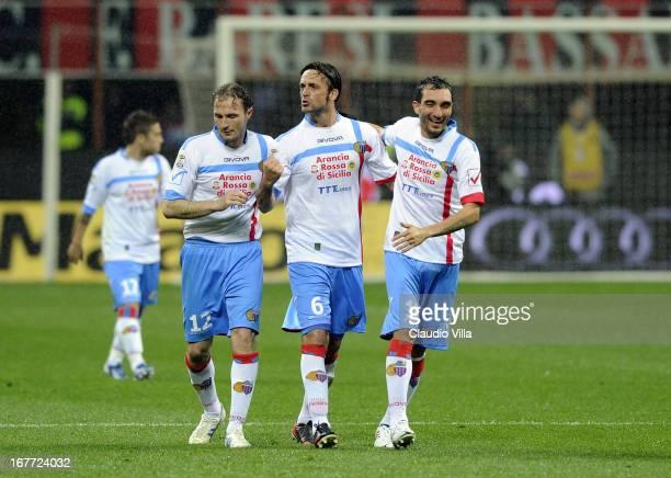 Nicola Legrottaglie of Calcio Catania celebrates scoring the first goal during the Serie A match between AC Milan and Calcio Catania at San Siro...