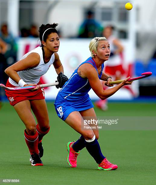 Nicola Lloyd of Scotland is challanged by Sam Quek of England during the Women's preliminaries match between Scotland and England at Glasgow National...