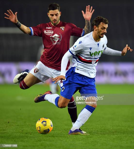 Nicola Murru of Torino F.C. Battles for possession with Manolo Gabbiadini of U.C. Sampdoria during the Serie A match between Torino FC and UC...
