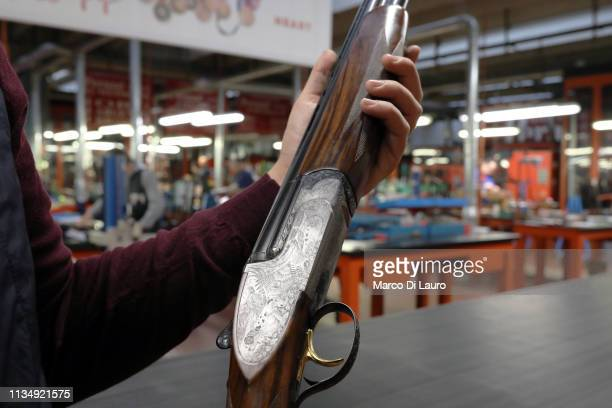 Nicola Perazzi holds a 97000 Euro shotgun on April 4 2019 at the Perazzi Armi factory in Botticino Mattina a village in the outskirt of the city of...