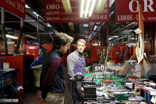 Nicola Perazzi talks to a technician from the repair and assistance department on April 4 2019 at the Perazzi Armi factory in Botticino Mattina a...
