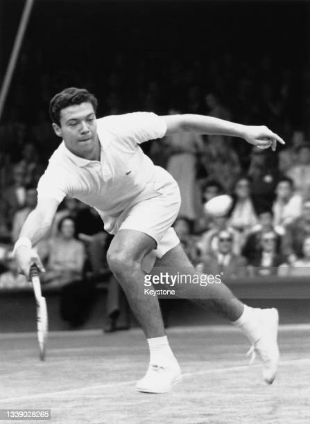 Nicola Pietrangeli of Italy looks at the tennis ball as he reaches to play forehand return to Kurt Nielsen of Denmark during their Men's Singles...