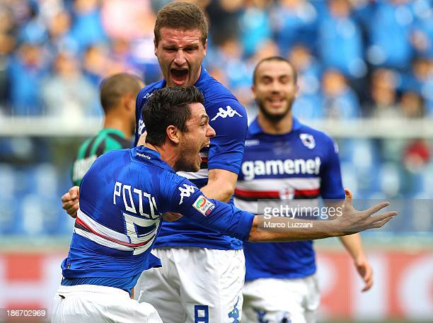 Nicola Pozzi of UC Sampdoria celebrates with his team-mate Shkodran Mustafi after scoring the opening goal during the Serie A match between UC...