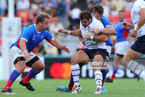 Nicola Quaglio of Italy is tackled during the Rugby World Cup 2019 Group B game between Italy and Namibia at Hanazono Rugby Stadium on September 22,...
