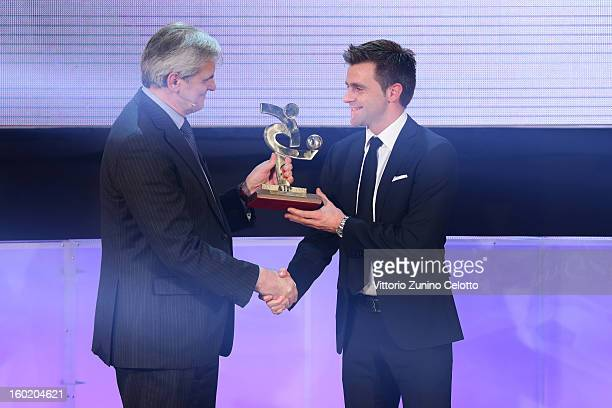 Nicola Rizzoli poses with the Aic award during the Gran Gala del Calcio Aic football awards ceremony at Teatro dal Verme on January 27 2013 in Milan...