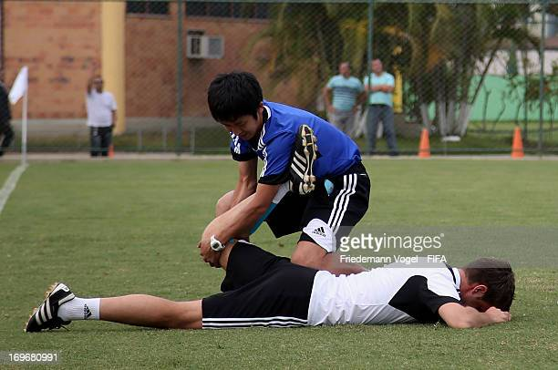 Nicola Rizzoli stretches during the Workshop for Prospective Referees for the 2014 FIFA World Cup at the Zico training center on May 29 2013 in Rio...