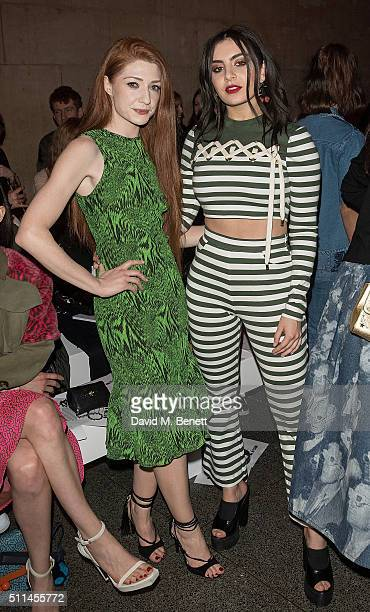 Nicola Roberts and Charli XCX attend the House of Holland show during London Fashion Week Autumn/Winter 2016/17 at TopShop Show Space on February 20...