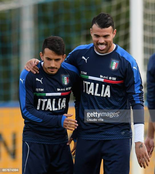 Nicola Sansone and Andrea Petagna of Italy chat during the training session at the club's training ground at Coverciano on March 25 2017 in Florence...