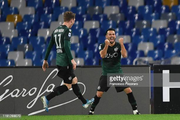 Nicola Sansone and Andreas Skov Olsen of Bologna FC celebrate the 12 goal scored by Nicola Sansone during the Serie A match between SSC Napoli and...