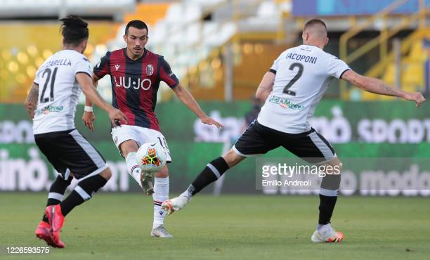 Nicola Sansone of Bologna FC is challenged by Simone Iacoponi of Parma Calcio during the Serie A match between Parma Calcio and Bologna FC at Stadio...