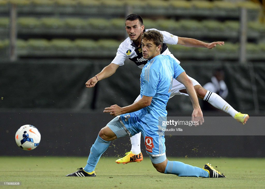 Nicola Sansone of Parma FC (L) and Lucas Mendes of Olympique Marseille compete for the ball during the pre-season friendly match between Parma FC and Olympique Marseille at Stadio Ennio Tardini on July 31, 2013 in Parma, Italy.