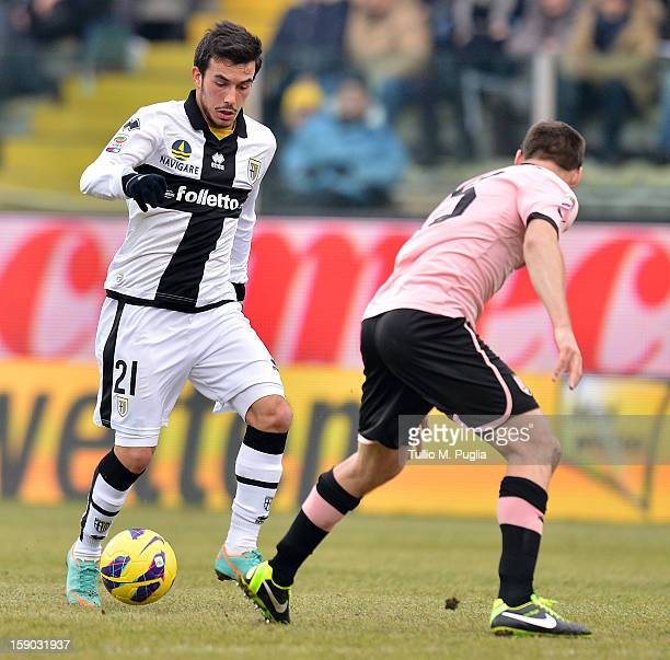 Nicola Sansone of Parma is challenged by Steve Von Bergen of Palermo during the Serie A match between Parma FC and US Citta di Palermo at Stadio...