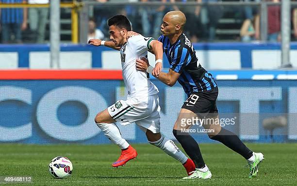 Nicola Sansone of US Sassuolo Calcio competes for the ball with Yohan Benalouane of Atalanta BC during the Serie A match between Atalanta BC and US...