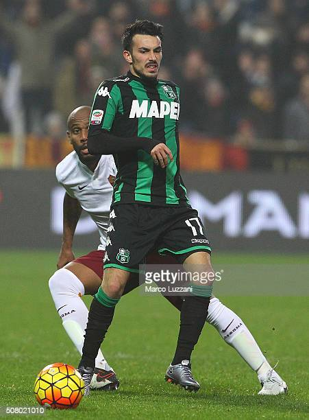 Nicola Sansone of US Sassuolo Calcio is challenged by Maicon Sisenado Douglas of AS Roma during the Serie A match between US Sassuolo Calcio and AS...