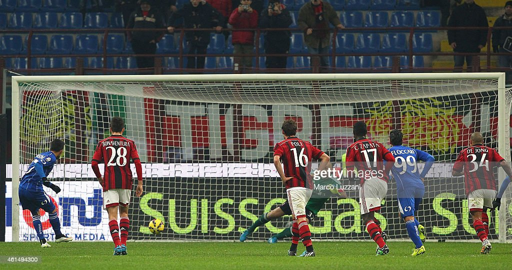 Nicola Sansone (L) of US Sassuolo Calcio scores his goal from the penalty spot during the TIM Cup match between AC Milan and US Sassuolo Calcio at Stadio Giuseppe Meazza on January 13, 2015 in Milan, Italy.